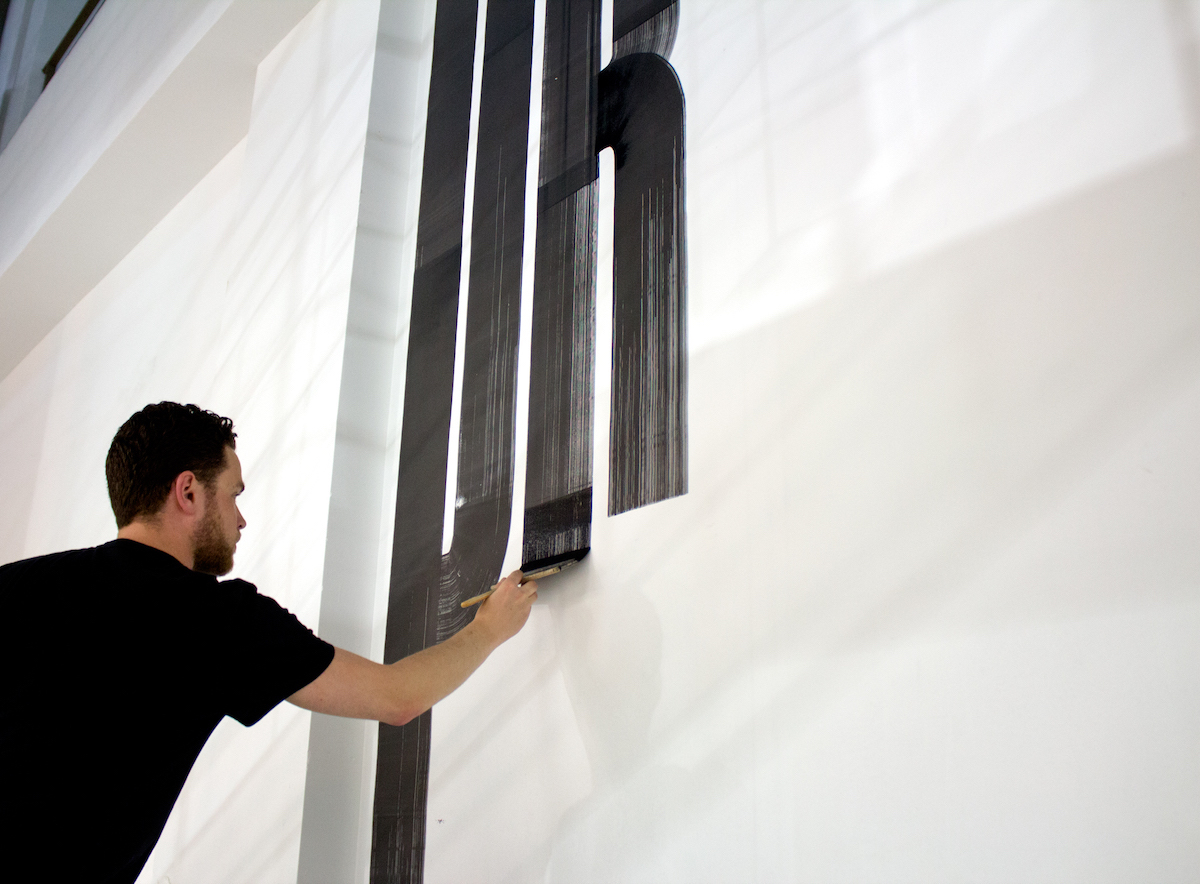 Guido mural painting in action.